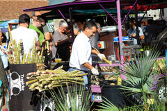 On the market can people taste freshly squeezed sugar cane Stock Images