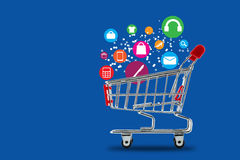 Market cart shopping online concept. On blue background Royalty Free Stock Photos