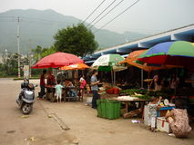 Market in China. People selling fruit and vegetables stock photography