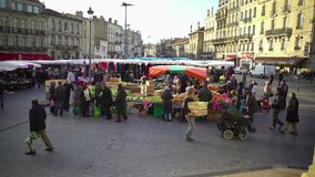 Market in city center, people buying vegetables and fruit, urban life, Europe stock video footage