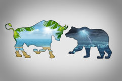 Market Climate. Economy concept with a tropical beach paradise scene contrasted with a stormy lightning cloud night in the shape of a bull and bear as financial Royalty Free Stock Images
