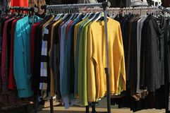 Market for clothes outdoor on a street in Pernik, Bulgaria -jan 27, 2018. Second hand clothes or new clothes. Sales. royalty free stock photography