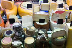Market counter with different cheese kinds Stock Image