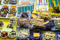Market counter with olives and olive products Royalty Free Stock Image
