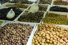 Market counter with olives Royalty Free Stock Images