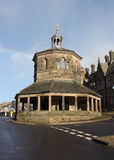 The Market Cross in Barnard Castle. A shot of the market cross in Barnard Castle with a rainbow behind in the blue sky Royalty Free Stock Images