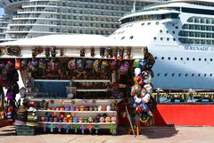 Market and cruise ship. This is one of many open air stands on the dock at Cozumel Mexico Stock Image