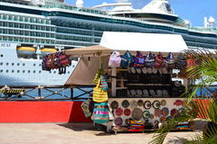 Market and cruise ship. This is one of many open air stands on the dock at Cozumel Mexico Stock Photo