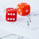 Market data and two red dice Royalty Free Stock Photos