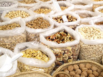 Market day. Fresh nuts and seeds on a street market stock photos