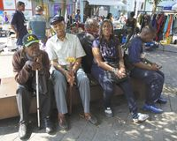 Market day. Maida Hill Market day group resting in the sun Royalty Free Stock Images