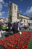 Market Day - Malton - Yorkshire - England. Buying strawberries on a market stall in the market town of Malton in North Yorkshire in the United Kingdom Royalty Free Stock Image