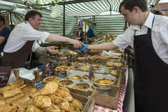 Market Day - Malton - Yorkshire - England. Market stall selling English pies and pastries on market day in the busy North Yorkshire town of Malton in northeast Stock Photo