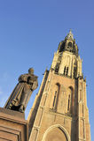 Market in Delft with old statue of Hugo de Groot. Market square in Delft with old statue of Hugo de Groot at the background the Nieuwe Kerk. In that church is royalty free stock photos