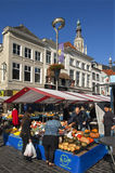 Market in the Dutch City Breda with fruit stall. Netherlands, province Noord-Brabant, city Breda: it is market day on the Grote Markt. People walk to shop Royalty Free Stock Photos