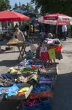 Market in fetesti. Market along the streets of Fetesti, a city north of Moldova, in the foreground a stall selling used clothes stock photos