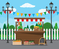 Market food stall full of groceries products. Traditional wooden market food stall full of groceries products with flags, crates and chalk board. Vector royalty free illustration