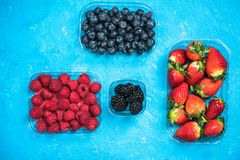 Market fresh mixed berry fruits, top view,. Market fresh mixed berry fruits, top view Royalty Free Stock Photo