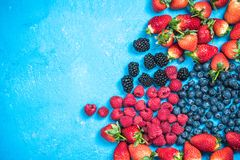 Market fresh mixed berry fruits, top view, border background.  Royalty Free Stock Image