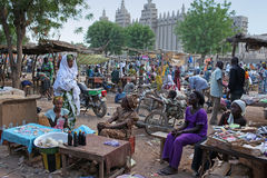 Market in front of theGreat mosque of Djenne, Mali Royalty Free Stock Images