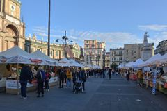 Tourists in a food and drink market in Naples. royalty free stock images