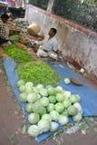 Market3. Goa, India - February 11, 2006:  Vegetable seller looks for customers. The Market in Chaudi Stock Image