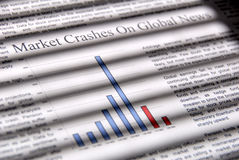 Market Goes Down. Selective focus closeup of fictitious news and graph indicating financial market downward movement, under dramatic lighting. (Photographer Stock Photography