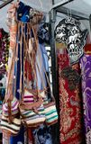 Market goods. Close up of a few knit purses and tribal cloth with a wooden sculpture of the African Continent at Greenmarket, Cape Town, South Africa royalty free stock image
