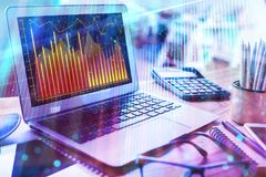 Market and growth concept. Laptop with forex chart placed on office desk with supplies. Market and growth concept. Double exposure Stock Photo