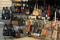 Market for handbags and purses on the street. Imitation of brand bags. Fake branded ladies hand. Market for handbags and purses on the street in Pernik, Bulgaria Stock Images