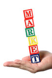 Market on haned. Business people holding market word on white background stock photos
