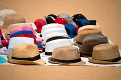 Market of Hats on Ground Stock Images