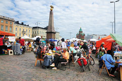 Market in Helsinki. A market in the harbour of Helsinki, Finland. The monument Keisarinnankivi and the Uspenski Cathedral can be seen in this picture royalty free stock image