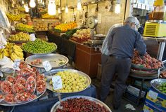 Market. A iranian man is buying fruits at the souk, the old traditional market, in Tehran, Iran Royalty Free Stock Photos