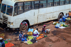 Market. Jinja, Uganda - September 2015 - A downtown fruits market scene. The ladies, who avail the fruits for sale in evenings, are mostly farmers from the Stock Photo