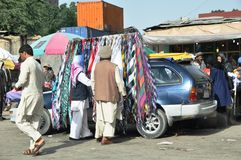 Market in Kabul, Afghanistan. Photo of a mobile scarf market in Kabul, Afghanistan Royalty Free Stock Images