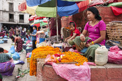 Market. KATHMANDU, NEPAL – CIRCA OCTOBER 2013: street trading is the basic form of selling in Nepal circa October 2013 in Kathmandu Royalty Free Stock Images