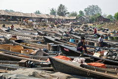 Market on Lake Inle. Parking the boat at Inle Lake market area in central Burma Stock Photo
