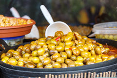 Market marinated olives. Variety of marinated olives displayed for sale Stock Photo