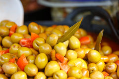 Market marinated olives. Variety of marinated olives displayed for sale Stock Images