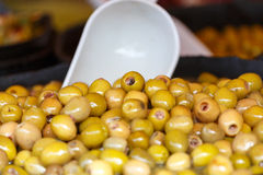 Market marinated olives. Variety of marinated olives displayed for sale Royalty Free Stock Images