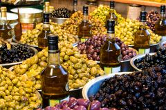 MARKET: OLIVES AND OIL. Olives and olive oil for sale at a market for farm products Stock Photo