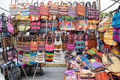Market in Otavalo, Ecuador. OTAVALO, ECUADOR - JAN 7, 2015: Colorful Souvenirs of the Otavalo market designed and built in 1970 by Dutch architect Tonny Zwollo stock photo