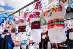 Market in Otavalo, Ecuador. OTAVALO, ECUADOR - JAN 7, 2015: Colorful Souvenirs of the Otavalo market designed and built in 1970 by Dutch architect Tonny Zwollo royalty free stock image