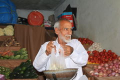 Market in Pakistan - Man selling vegetables Royalty Free Stock Photo