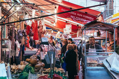 Market. PALERMO, ITALY - MARCH 13, 2015: Butcher sells meat at famous local market Ballaro in Palermo, Italy Stock Images