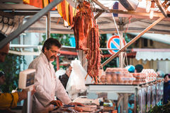 Market. PALERMO, ITALY - MARCH 13, 2015: Butcher sells meat at famous local market Ballaro in Palermo, Italy Royalty Free Stock Photography