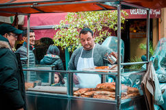 Market. PALERMO, ITALY - MARCH 13, 2015: Street food vendor at famous local market Ballaro in Palermo, Italy Stock Photos
