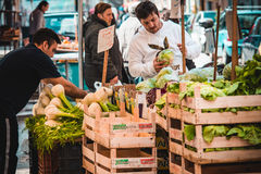 Market. PALERMO, ITALY - MARCH 13, 2015: Vendors sell fennel at famous local market Ballaro in Palermo, Italy Royalty Free Stock Image