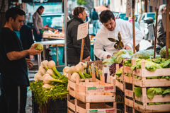 Market. PALERMO, ITALY - MARCH 13, 2015: Vendors sell fennel at famous local market Ballaro in Palermo, Italy Royalty Free Stock Images